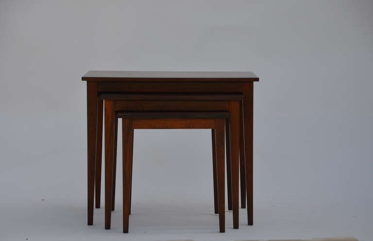 Set of chic Danish rosewood nesting tables. Incredibly beautiful solid rosewood construction. Very versatile and sturdy.