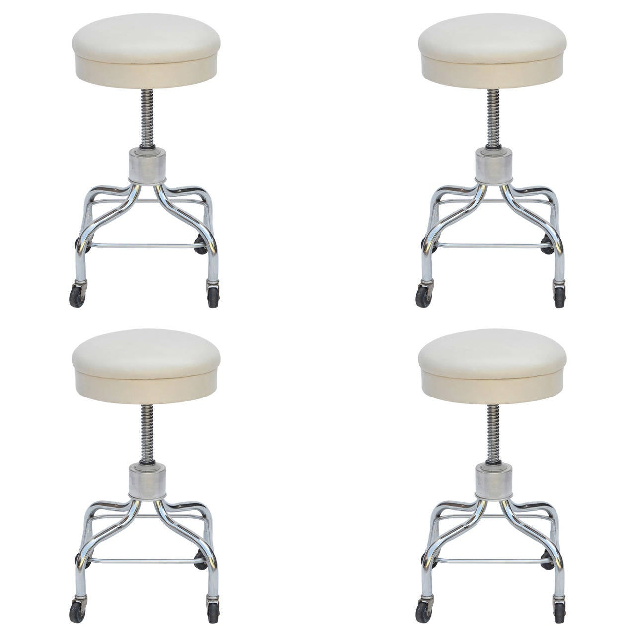 Set of Four Vintage Chrome and White Leather Adjustable Rolling Stools For Sale