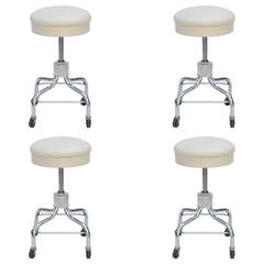 Set of Four Vintage Chrome and White Leather Adjustable Rolling Stools