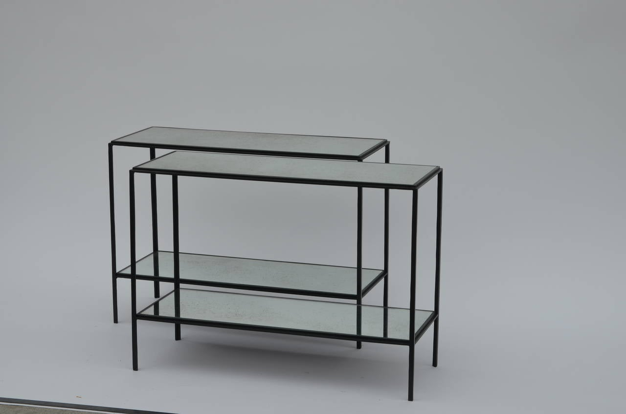 Pair of chic 'Rectiligne' mirrored wrought iron two-tier end / side tables by Design Frères. Lower shelf is at 6 in. from floor.