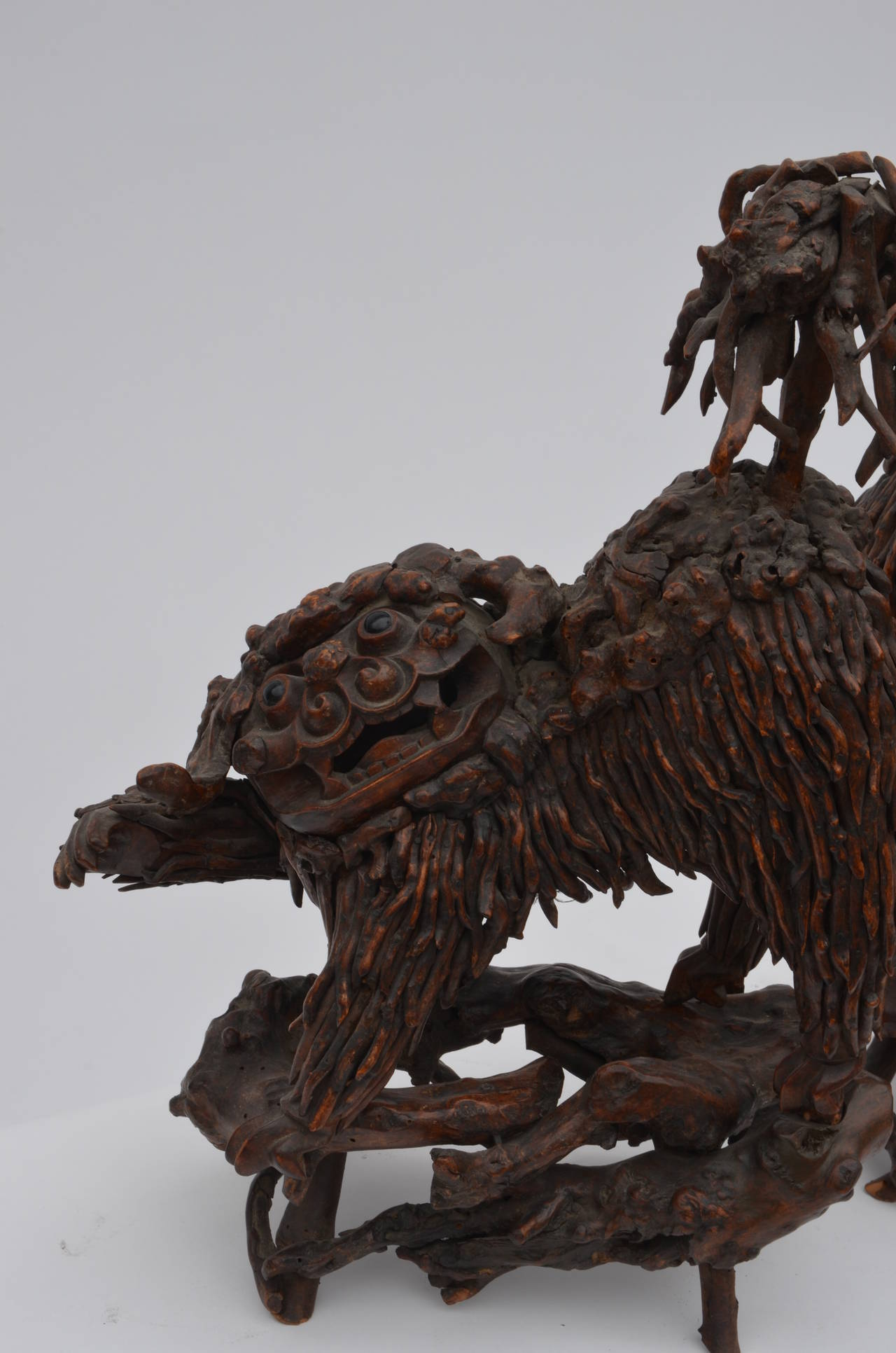 Pair of Rare Chinese Carved Wood Foo Dogs In Good Condition For Sale In Los Angeles, CA