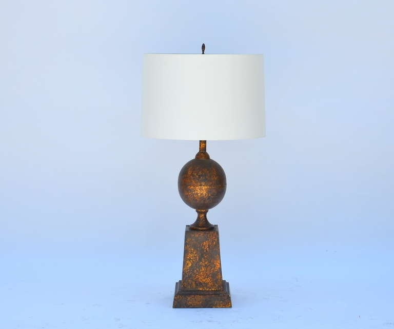 Large gilt tole neoclassical lamp with custom shade.