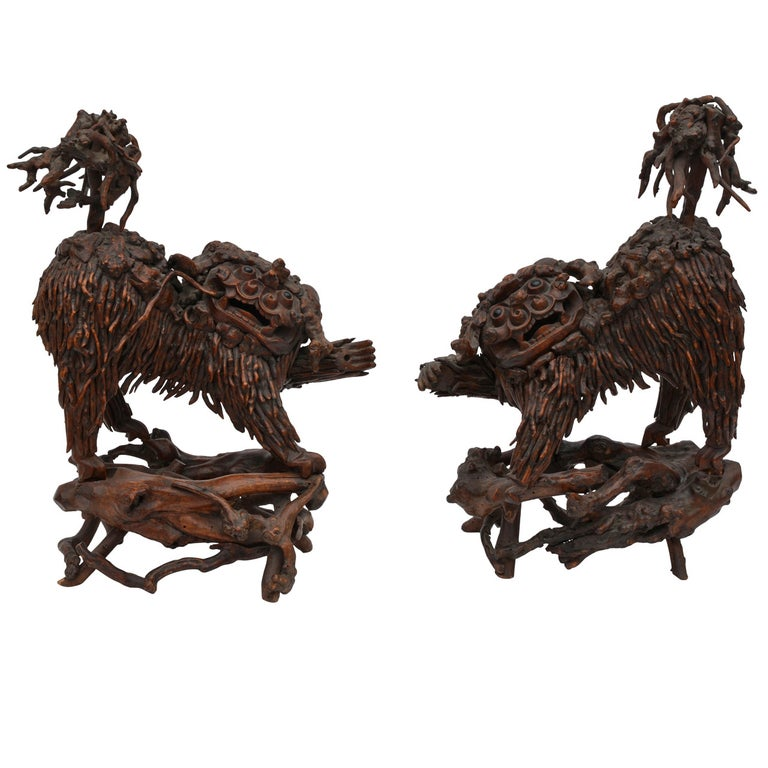 Pair of Rare Chinese Carved Wood Foo Dogs For Sale