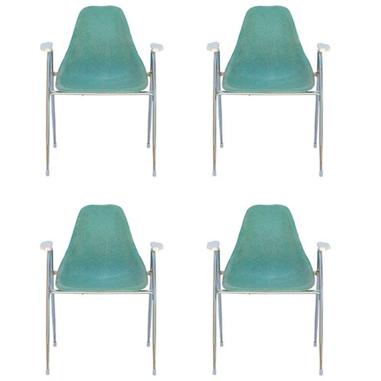 Set of Four Comfortable Turquoise Fiberglass Armchairs on Chrome Bases