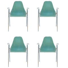 Set of Four Comfortable Turquoise Fiberglass Armchairs on Chrome Bases