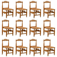 Rare Set of 12 Guillerme et Chambron Blond Oak and Rush Chairs
