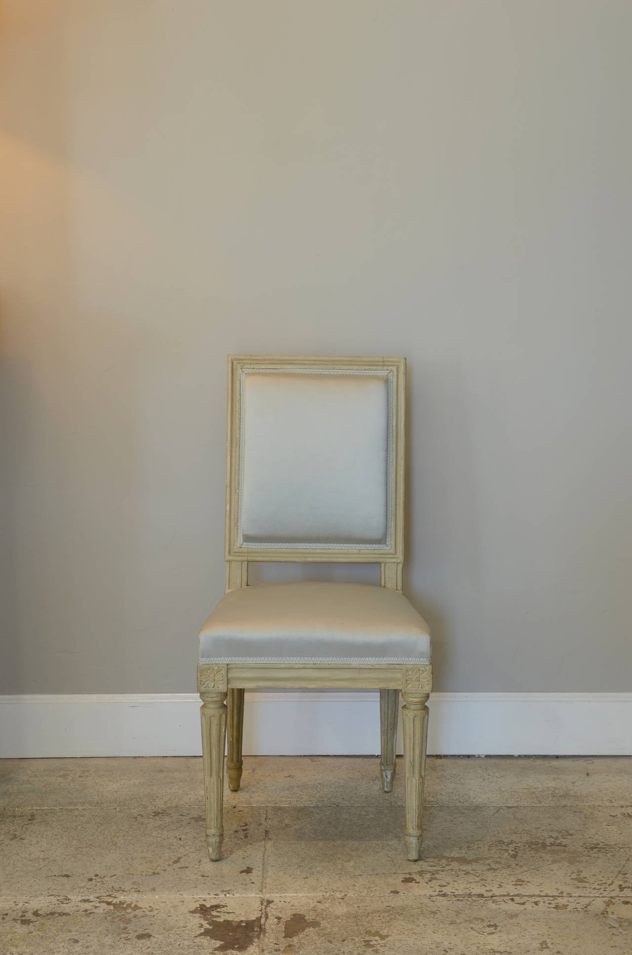 Pair of Chic Louis XVI style side chairs by Armand-Albert Rateau.  Stamped A A RATEAU and numbered.  Armand-Albert Rateau (1882 - 1938) was a French furniture maker and interior designer. In 2006, The Grove Encyclopedia of Decorative Arts