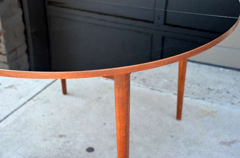 chic scandinavian teak table with durable black laminate top for sale