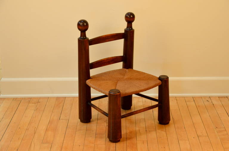 Single turned wood and rush children's chair in the style of Charlotte Perriand. Can also be used as a stool.