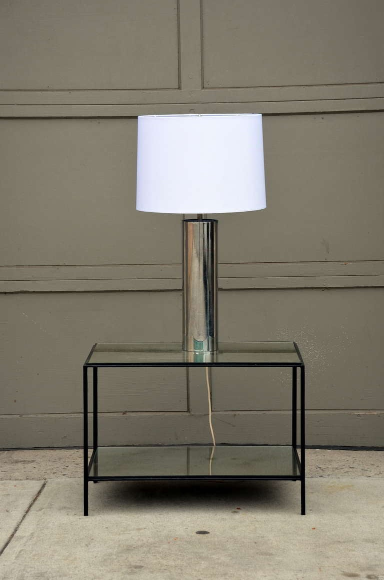 Minimalistic chrome cylinder table lamp by George Kovacs. New custom white fabric shade. Understated elegance.