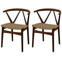 Pair of Sculptural Wishbone chairs by Henning Kjaernulf for Bruno Hansen