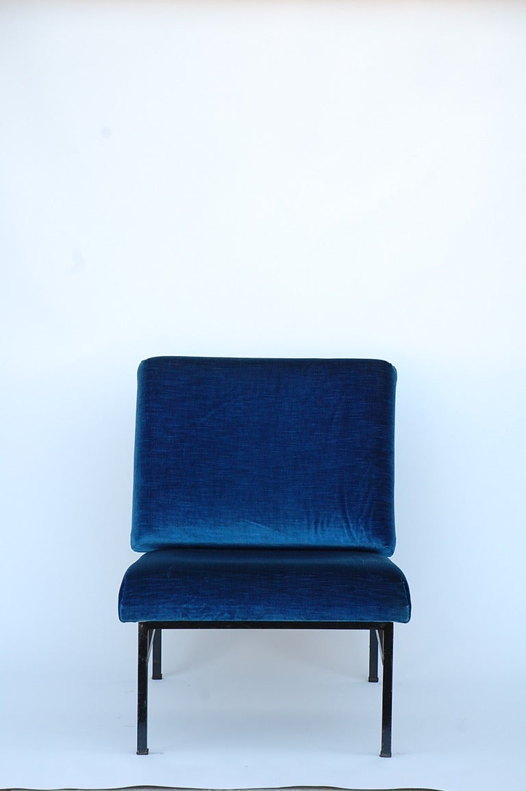 Pair of French 50's blue velvet lounge chairs in the style of Pierre Guariche. 15.5 in. seat height.