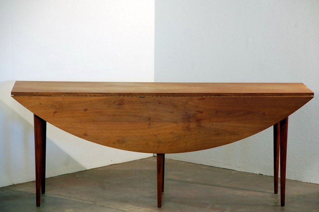 this oval drop leaf dining table by edward wormley for dunbar is no