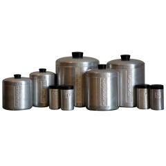 Set of decorative machine age aluminum kitchen containers