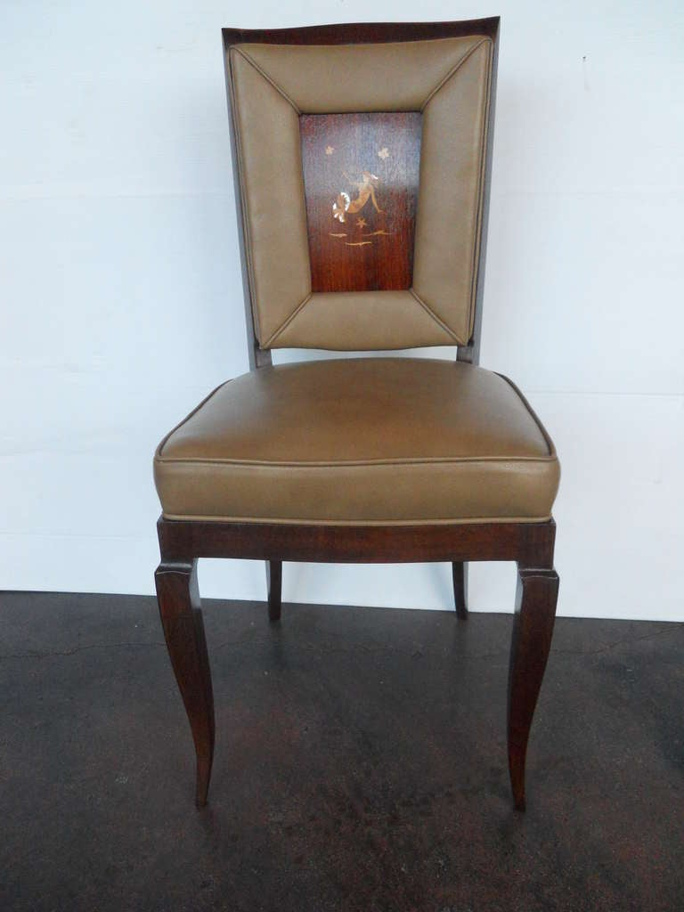 Exceptional set of 6 chairs.  Mother of pearl and maple inlay on rosewood.  Newly refinished and upholstered in leather.