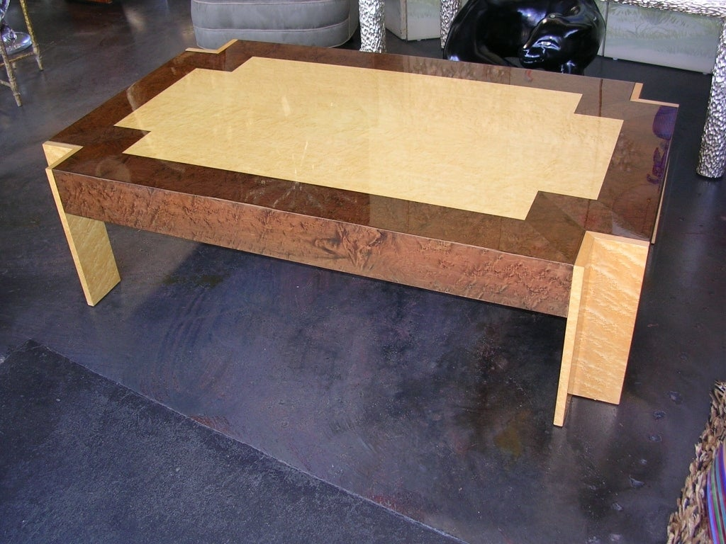 A two tone birds eye maple coffee table with clipped corners. Finish is an a beige and medium brown lacquer.
