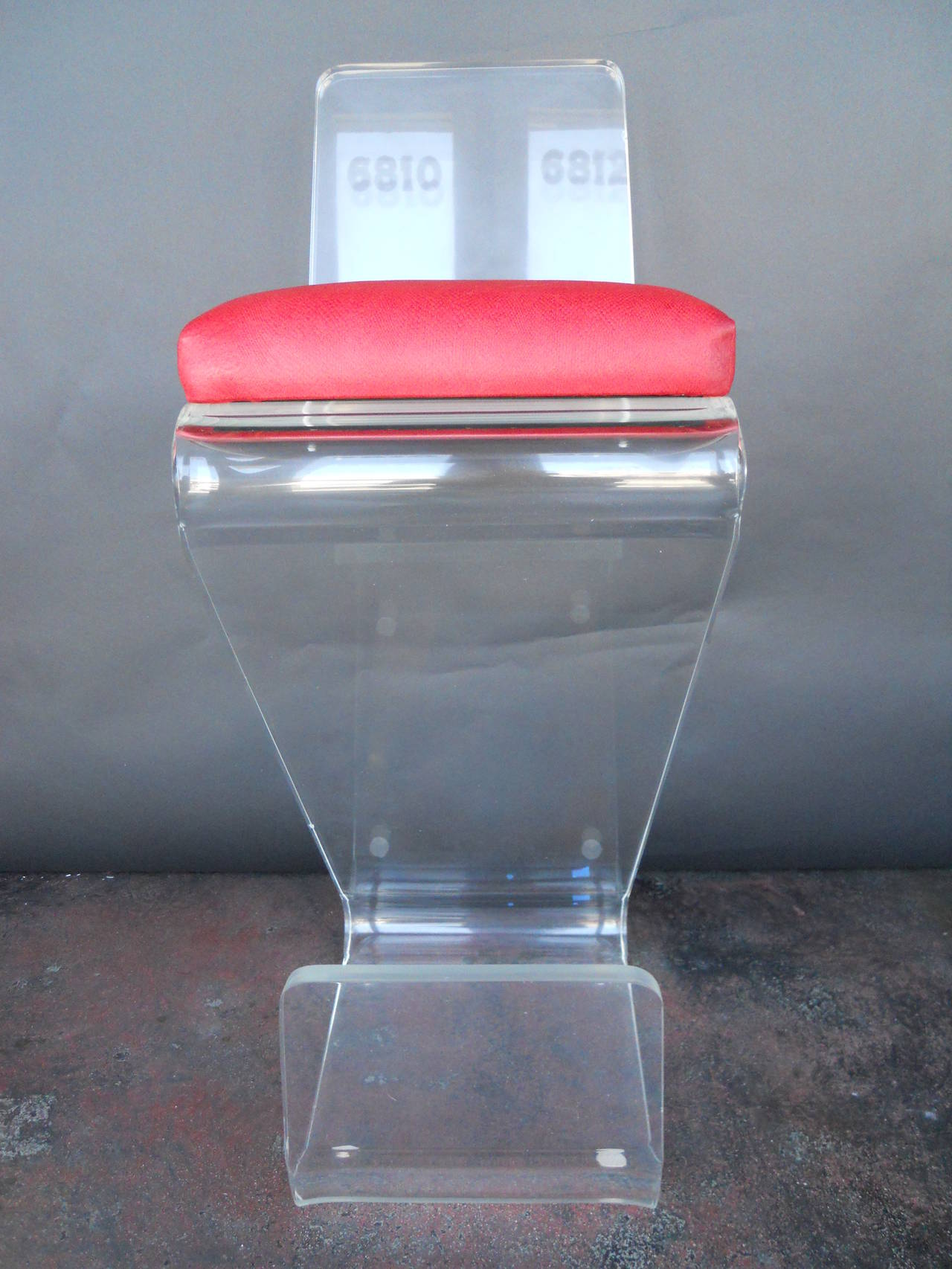 Pair of Vintage Lucite Bar Stools, newly upholstered in red geniune leather