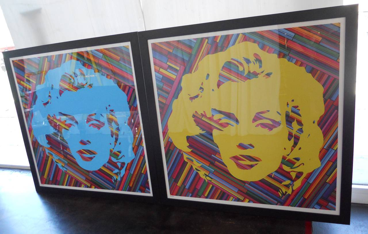 Set of two Mauro Oliveira Marilyn Monroe lithographs.  Artwork signed and dated by artist. Mauro is a Brazilian artist who immigrated to the US and currently lives in Los Angeles. Wood frame. Limited edition 1 of 50.