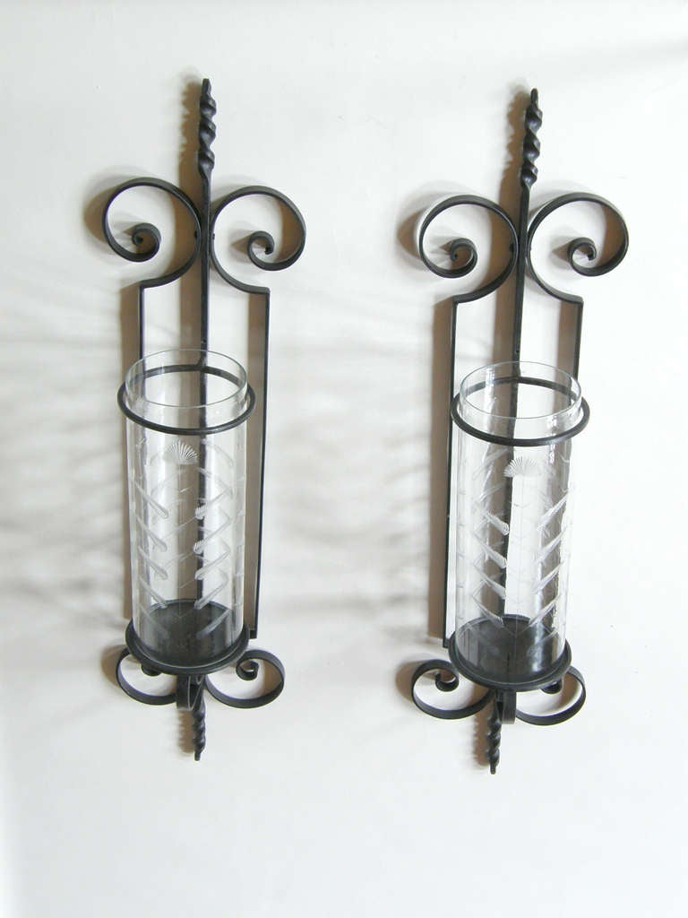 Monumental, wall mount hurricane candle sconces with etched glass shields.  Please contact us if you have any questions.
