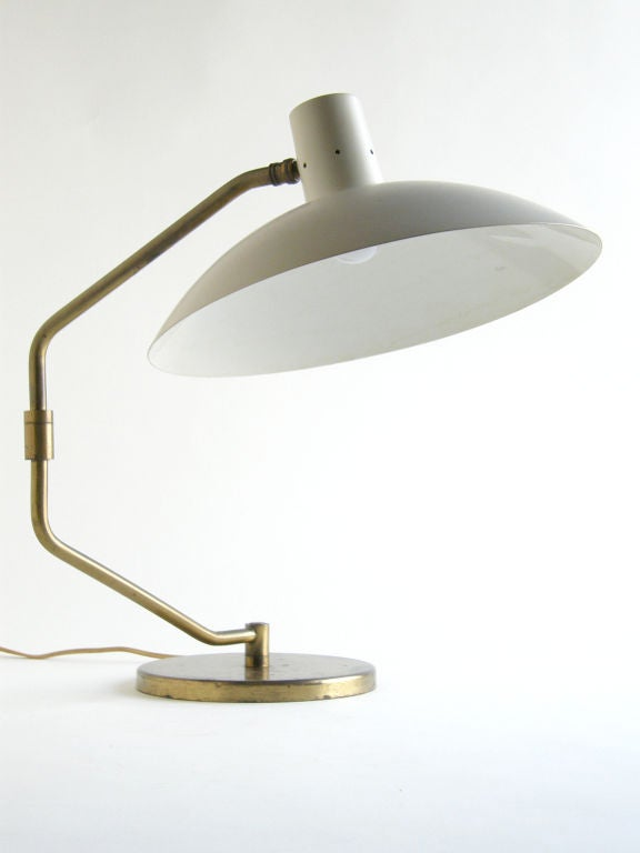 One of the first offerings in lighting by Knoll was Clay Michie's desk lamp. It has excellent functionality. The swiveling arm gives it a long reach, and the ball and socket joint provides a range of adjustable positioning of the shade.  Produced