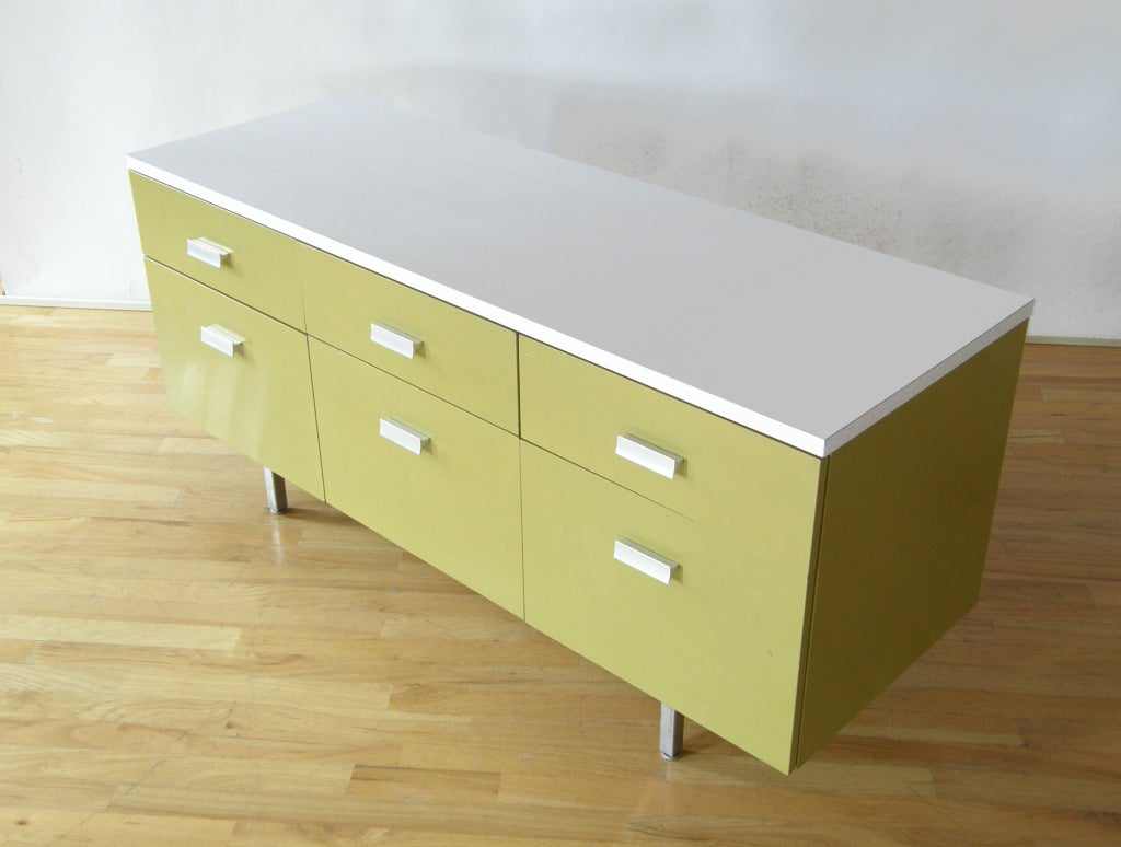 """""""Modern Management"""" credenza designed by George Nelson for Herman Miller.   A good effort by Nelson to reinvent the metal (fireproof) furniture of the 1930s. Please use the Contact Dealer button if you have any questions."""