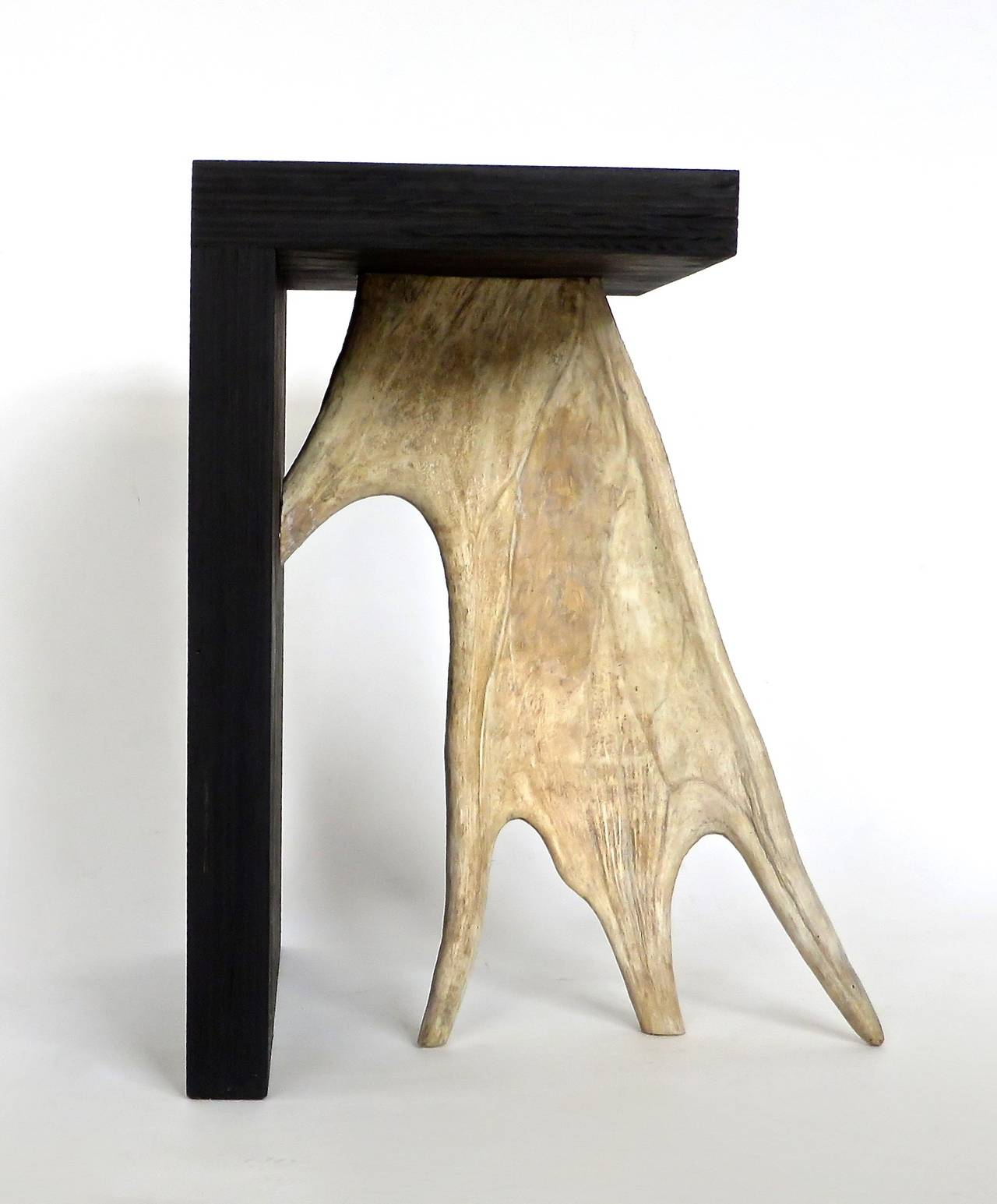 Black stained solid wood with elk antler. 