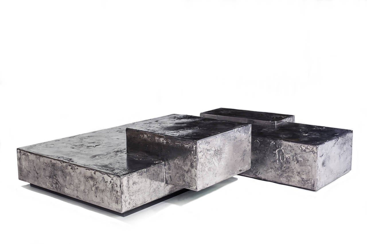 The Landscape coffee table is comprised of 4 interlocking levels of steel with a hand applied textured pewter finish by contemporary designer Christopher Gentner.  