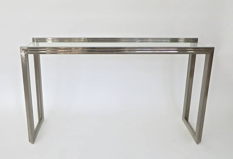 Stepped ziggurat stepped motif chrome console with glass plateau by Italian designer Romeo Rega. Excellent and elegant proportions and no scratches to the steel. Excellent condition.