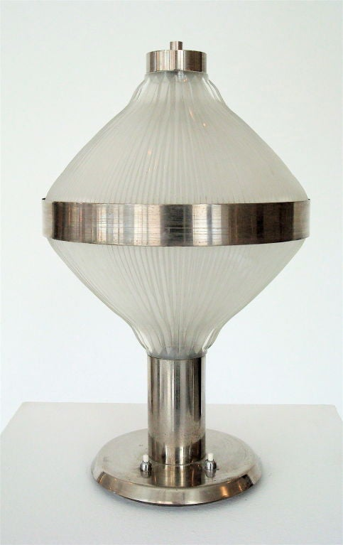 Polinnia, table lamp designed by L. Belgioioso, E. Peressutti, E. Rodgers Architechts for Artemide. Italy c 1964 for Artemide.  B.B.P.R Architects. Dual light source. All original condition.