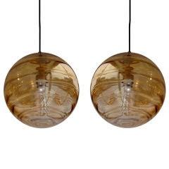 Pair of Italian Hand Blown Amber Glass Pendant Lights