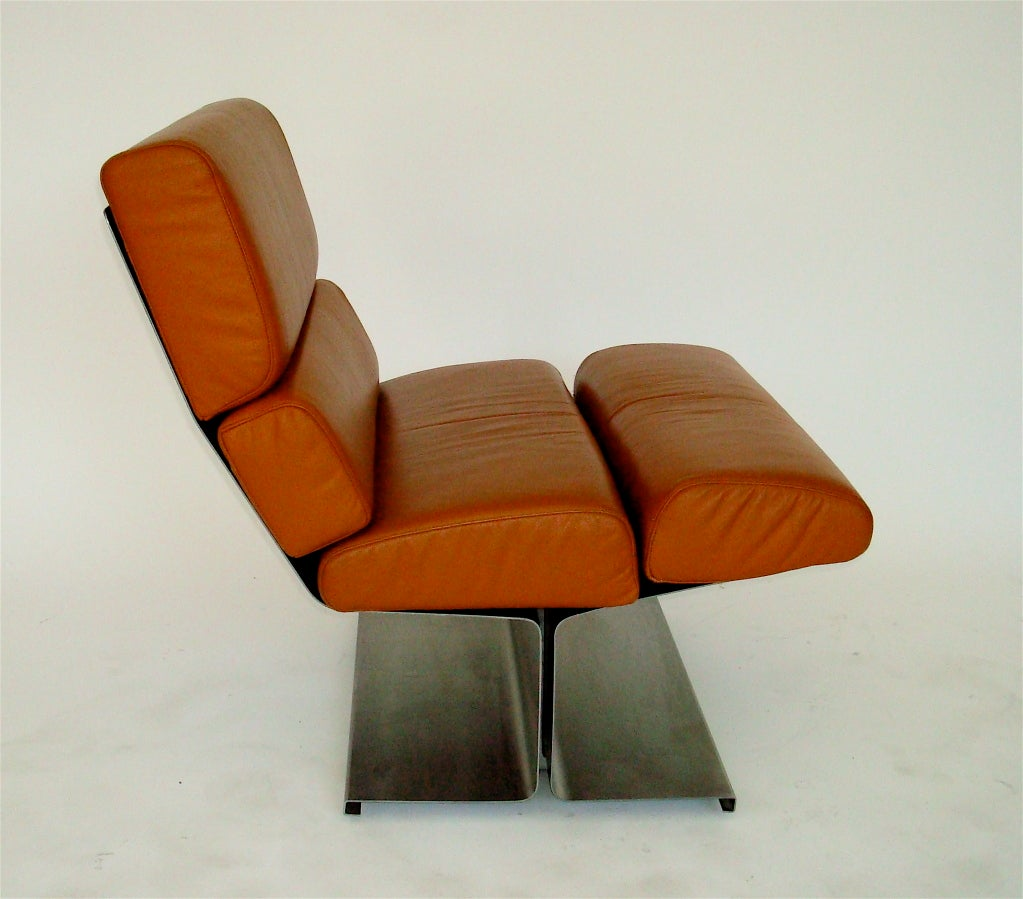 Incredible pair of French brushed stainless steel and leather lounge chairs, chic and super comfortable by Francois Monnet edition by Uginox, circa 1970. With leather cushions in good condition.