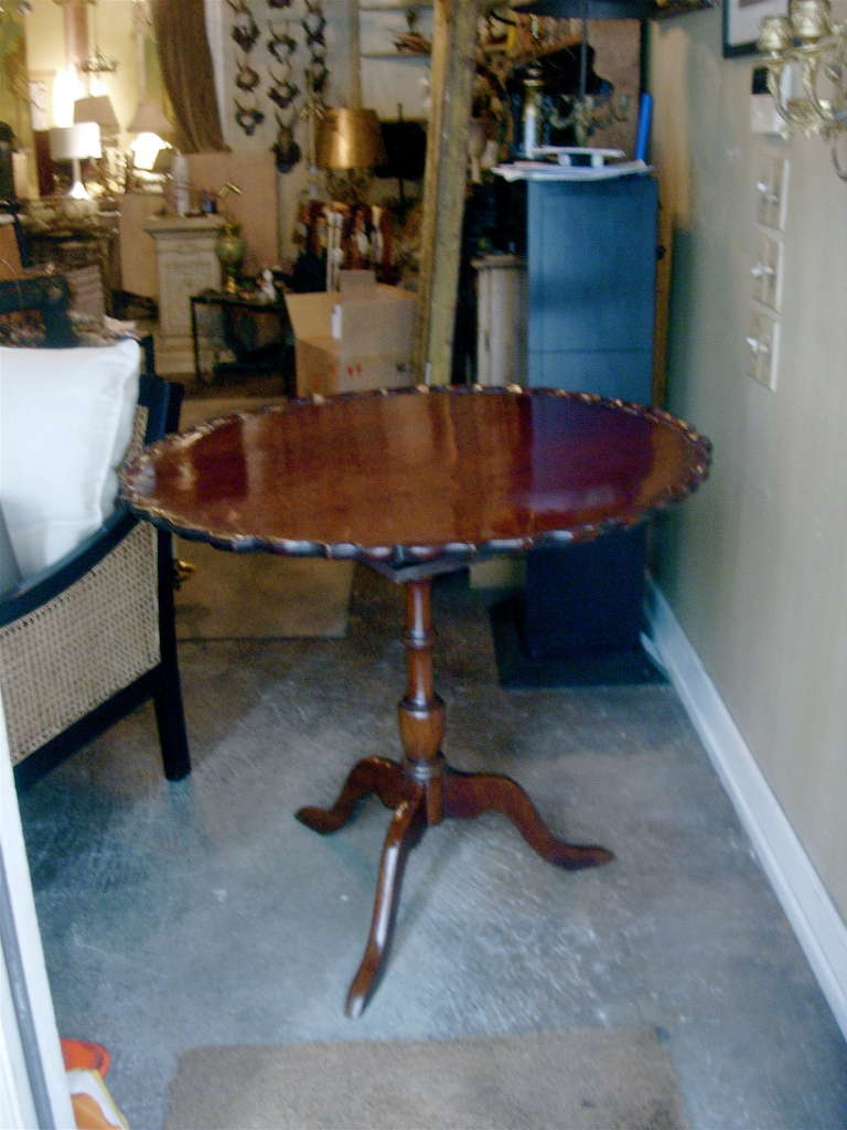 19th century American or English tea or center tilt-top table. Great height. Nice old patina.