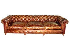 Pair of Monumental Distressed Leather Chesterfield Sofas. Priced Per Sofa.