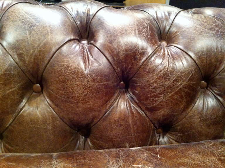 20th Century Pair of Monumental Distressed Leather Chesterfield Sofas. Priced Per Sofa. For Sale