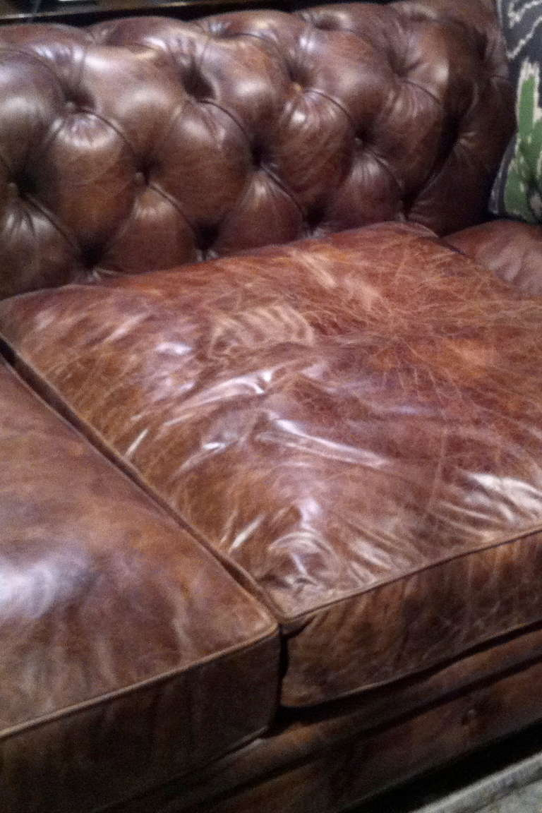 Wood Pair of Monumental Distressed Leather Chesterfield Sofas. Priced Per Sofa. For Sale
