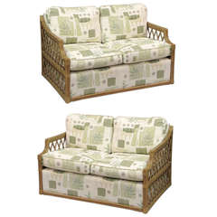 Pair of Rattan and Upholstered Settees in the Manner of McGuire