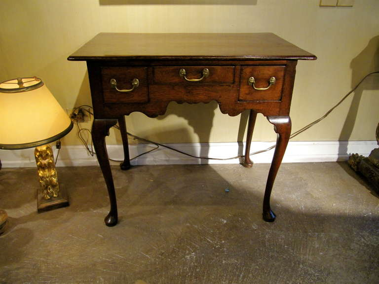 Handsome 18th century English oak lowboy, original hardware, lovely old color and patination.