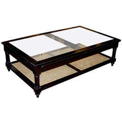 Anglo Indian Style Ebonized Wood, Glass And Cane Coffee Table