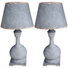 One pair of industrial patinated metal lamps with tole shades.