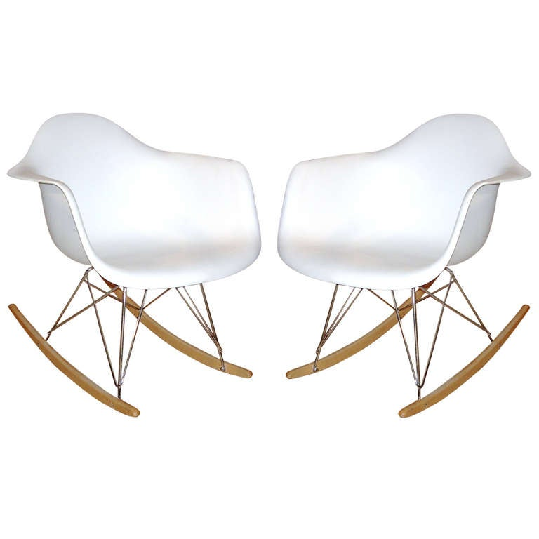 pair of eames style white shell rocking chair with metal