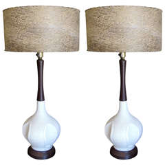 One pair of white ceramic textural mid century lamps with period shades