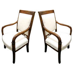 Exceptional Pair of French Empire Walnut Fauteuils