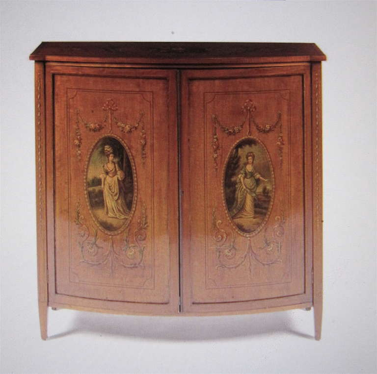 19th century English Adams satinwood cabinet with painted decoration.