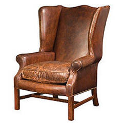 One Pair of Distressed Leather Wingback Chairs