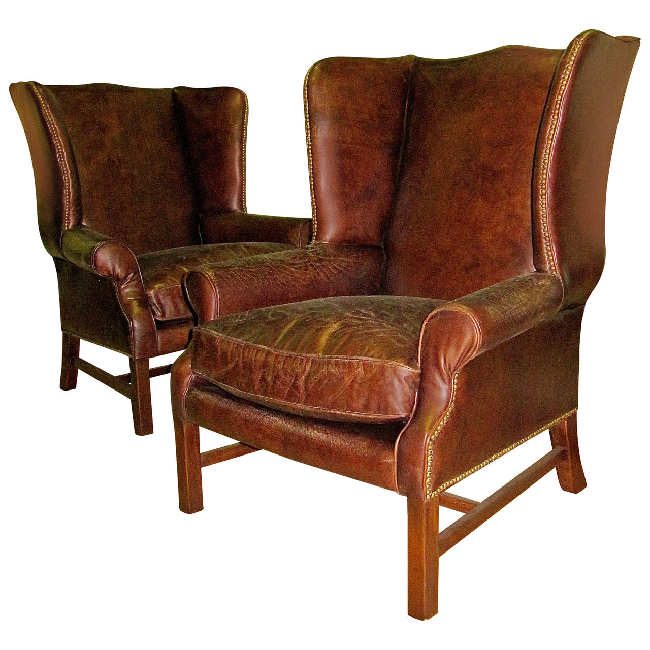 Two George Iii Style Wingback Chairs With Distressed Leather For