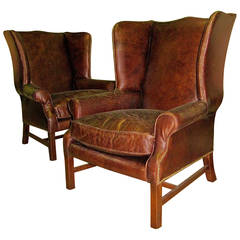 Two George III Style Wingback Chairs with Distressed Leather