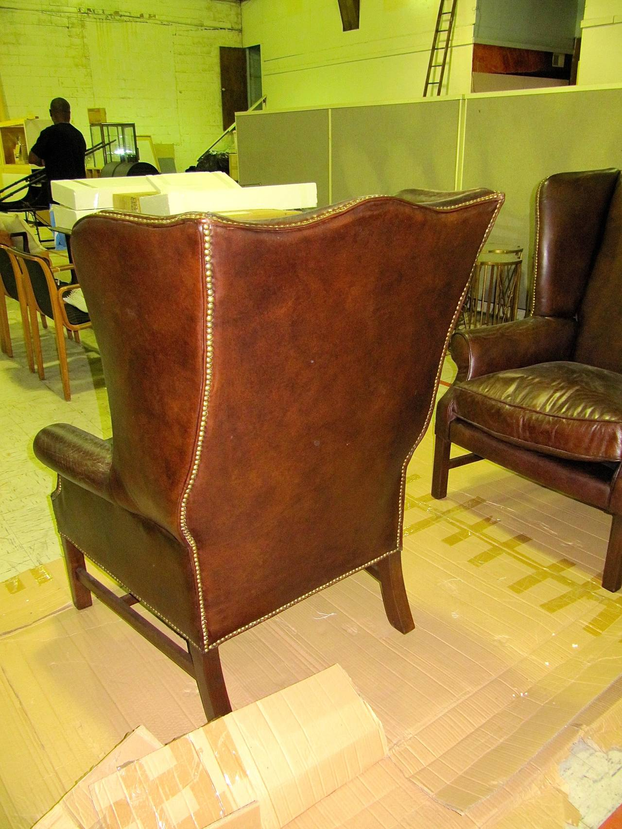 20th Century Two George III Style Wingback Chairs with Distressed Leather For Sale