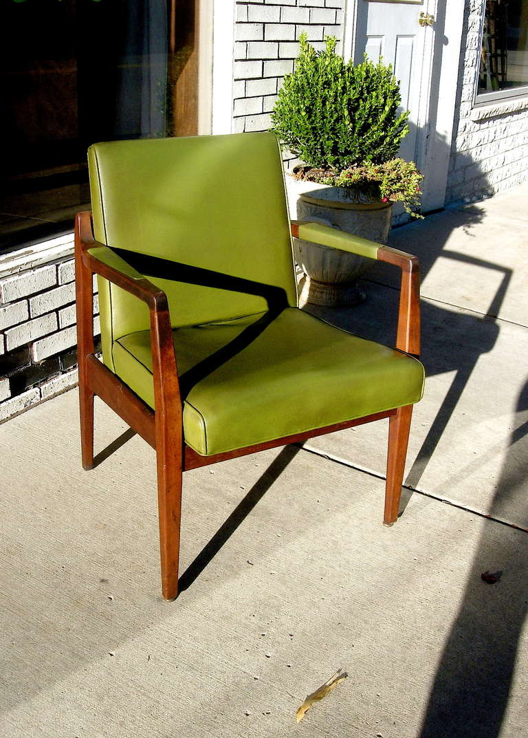 One pair of Mid-Centuryleather and solid mahogany armchairs by Marble Chair Company. Very solidly built and leather is in very good condition.