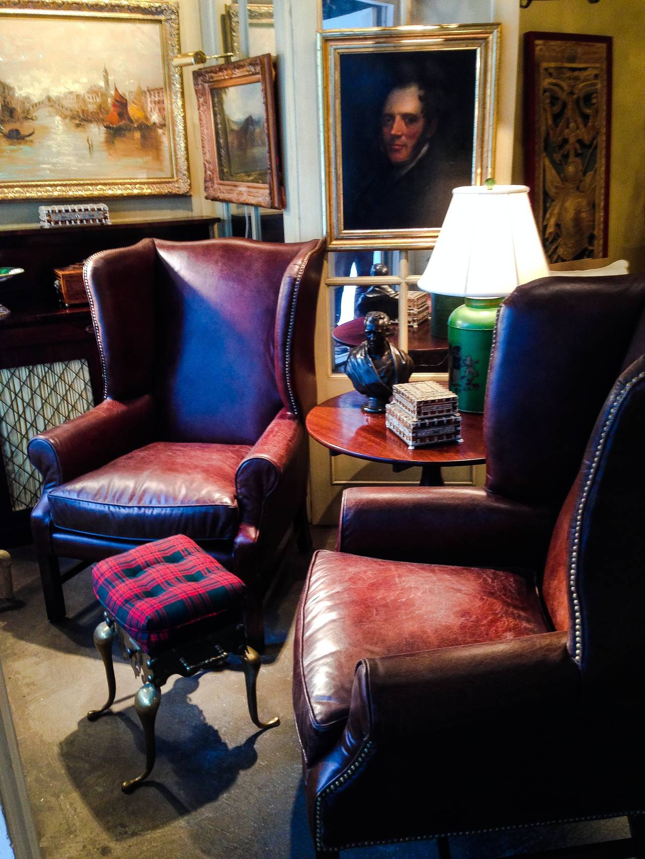 Two handsome George III style wingback chairs with nailhead and distressed leather. Nice deep wingback enclosure and leather has a lovely distressed finish yet in pristine condition. Very structurally sound. Note priced per chair and have four out