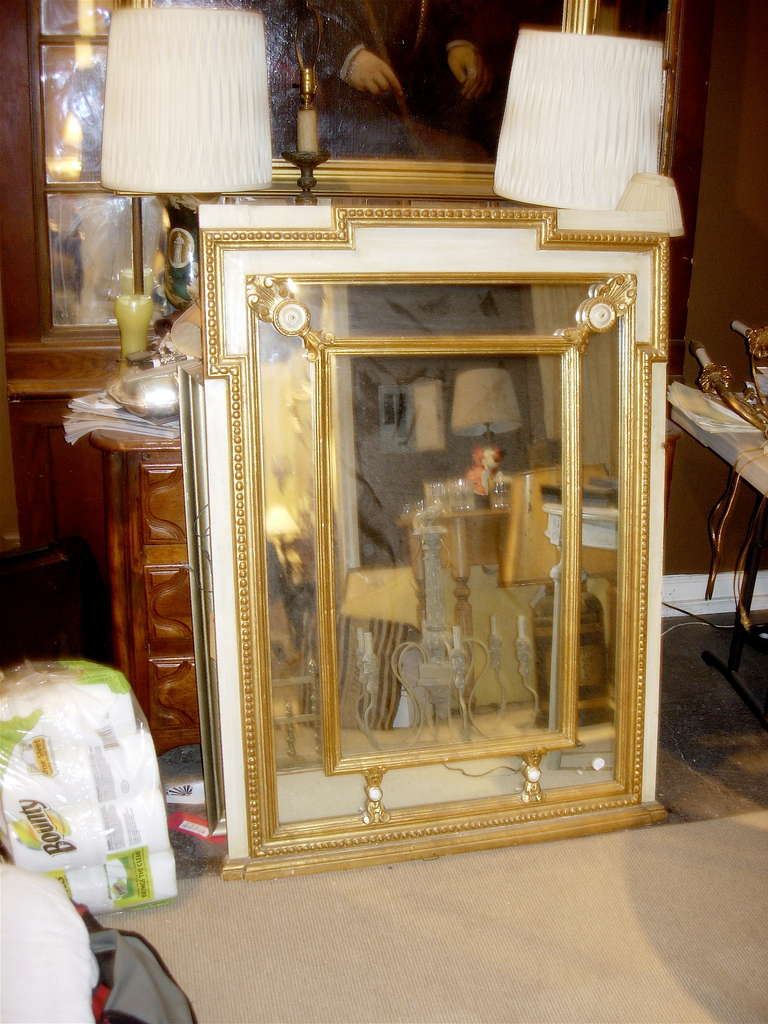 Regency style mirror with painted and giltwood decoration.